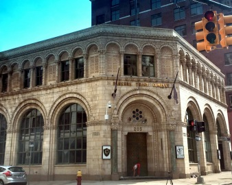 A fitness blogger films a workout in the doorway of this building by Wirt Rowland, architect of the Guardian Building.